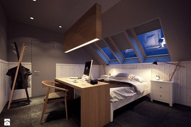 Sypialnia na poddaszu w ciemnej aranżacji